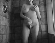 Wet soapy big natural juggs in the shower